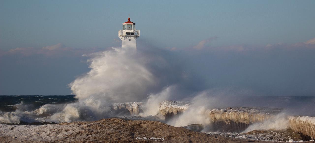 Sodus Point Pier as the waves crash along shore (photo)